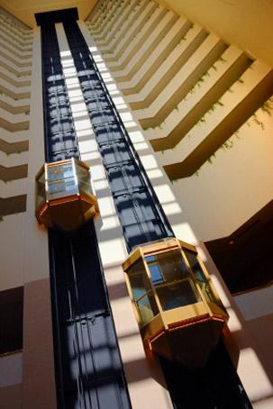 stock-photo-2175293-exposed-elevators-in-hotel-atrium